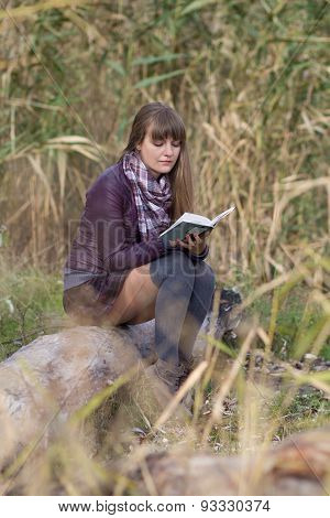 Girl With A Book On The Nature