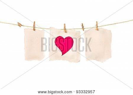 Red Heart Paper Cut On Brown Paper In Pin On White Background