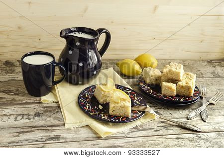 Slices Of Lemon Crumble And A Cup Of Milk