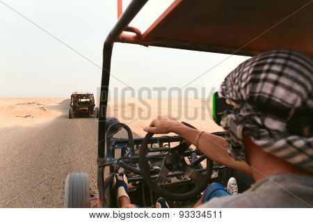 Men Riding Buggy Car In Desert