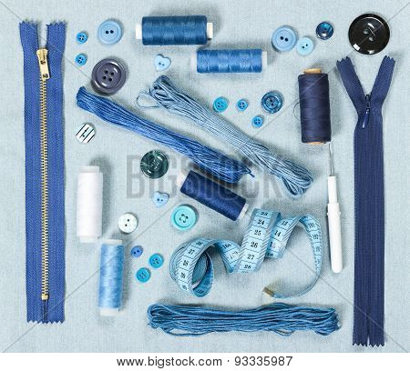 Sewing Accessories On Blue Denim Background.