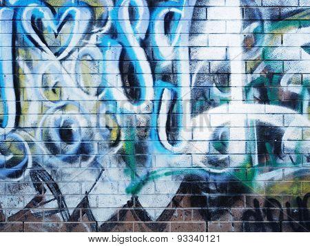 Graffiti on a urban brick wall