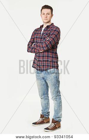 Full Length Portrait Of Man Standing In Studio On White Backgrou