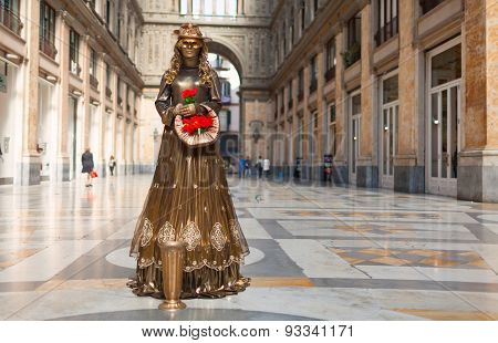 Street actor dressed as a golden lady. Naples, Italy