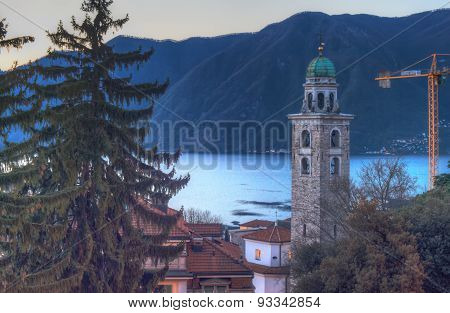 The Bell Tower And Lake Lugano