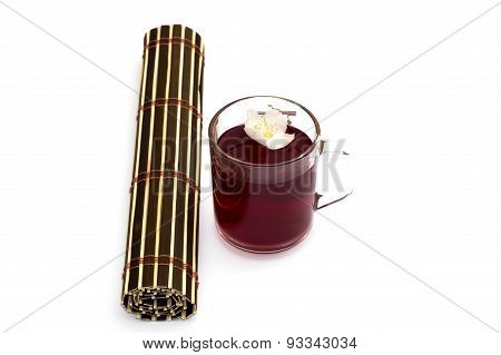 Glass Of Red Tea Nearby The Rug Twisted