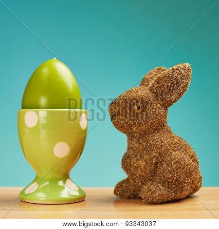 Toy rabbit next to an egg holder