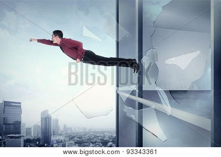 Business Man Flying Through Office Building Window