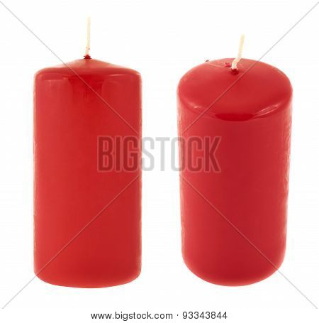 Red cylindrical wax candle isolated