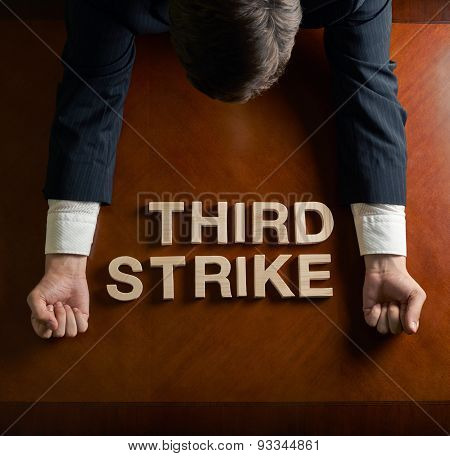 Phrase Third Strike and devastated man composition