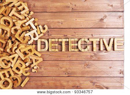 Word detective made with wooden letters