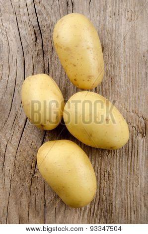 Raw Potato On An Rustic Table
