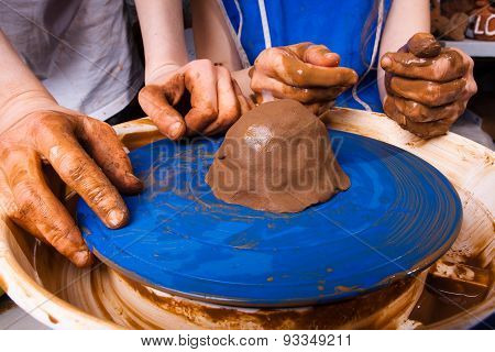 Potter Teaches To Sculpt In Clay Pot On Pottery Wheel