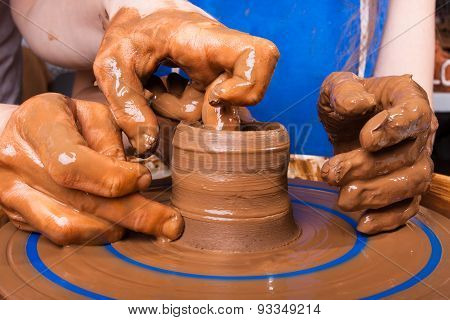 Potter Teaches To Sculpt In Clay Pot