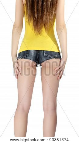Ass Woman Wearing A Short Jeans Shorts With Yellow Tank Top