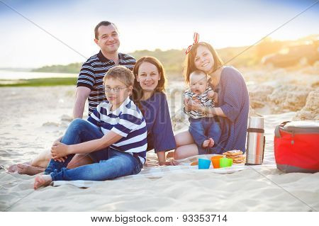 Family Of Five Having Fun On The Beach