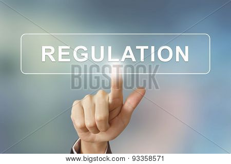 Business Hand Clicking Regulation Button On Blurred Background