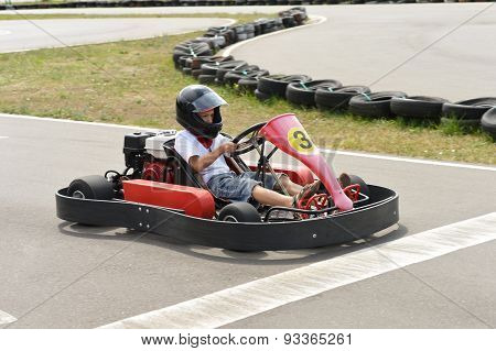 Teenage boy sitting in go-kart