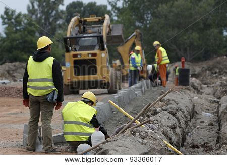 Workers Road Construction Site