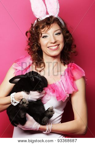 happy woman with black rabbit