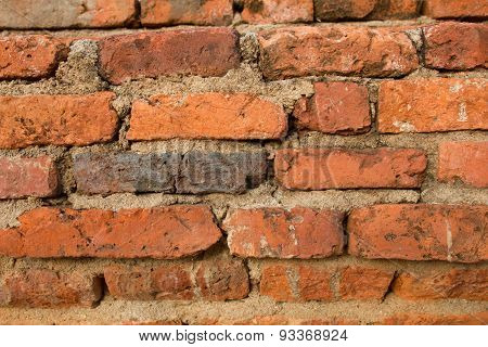 Red brick background: closeup of an old vintage red brick wall.