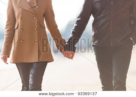 Couple is holding each other hands
