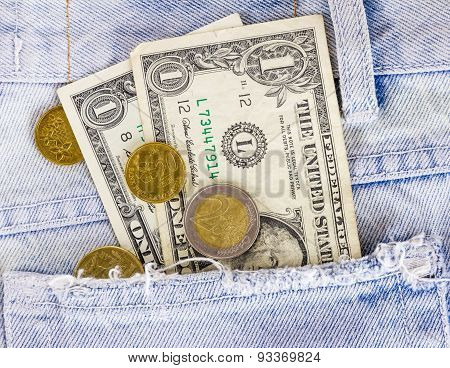 The Money On Jean Background Dollars And Coin.