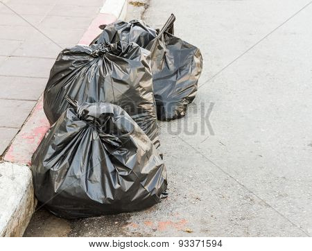 The Garbage Bags On Road.