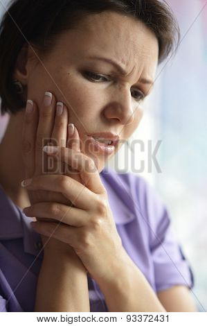 Sick woman with tooth pain