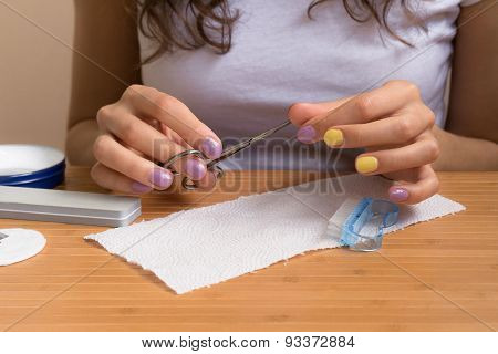 Female Hands Holding Nail Clippers