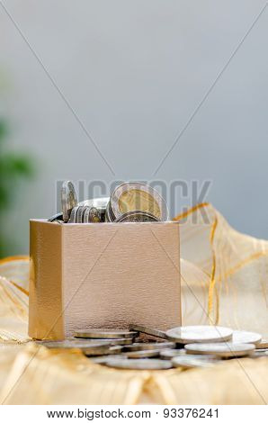 Gift Box Overflowing With Coin