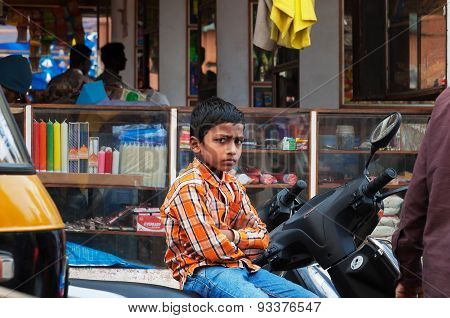 Indian Young Boy Sitting On The Bike At The Russell Market In Bangalore