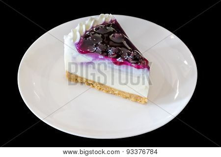 Blueberry Cheesecake On White Plate
