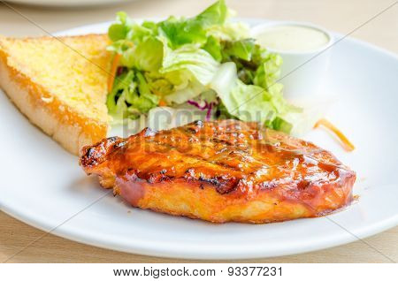 Chicken Steak On White Dish With Salad And Bread