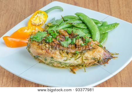 Baked Chicken Over White Dish On Wooden Table