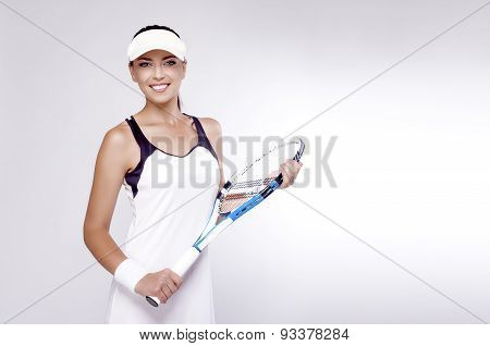 Tennis Concept And Ideas: Female Tennis Player Equipped In Professional Gear  Holding Racket In Fron