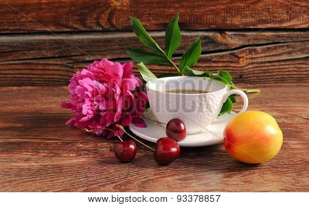 Still life with fresh berries and flowers.