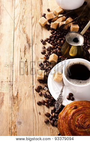 Old coffee pot and cup on wooden rustic background
