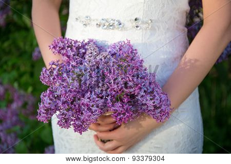 Beautiful Bouquet Of Lilac Flowers In Bride's Hands