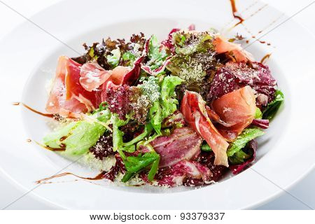 Restaurant Food Closeup - Salad With Prosciutto And Vegetables