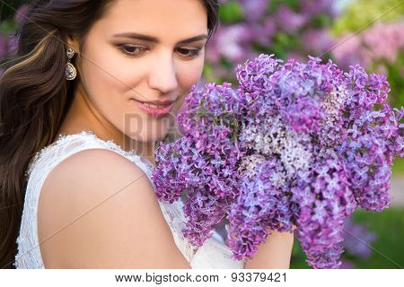 Close Up Portrait Of Beautiful Bride With Big Bouquet Of Lilac Flowers