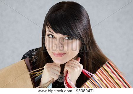 Young Beautiful Smiling Woman Holding Paper Bags With Purchases