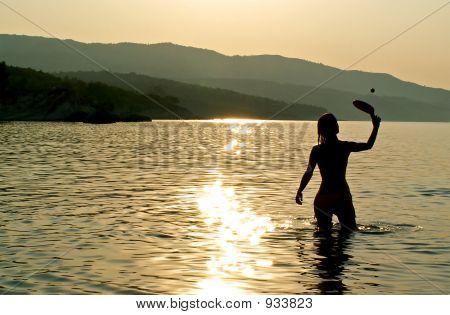 Girl Playing In The Sea