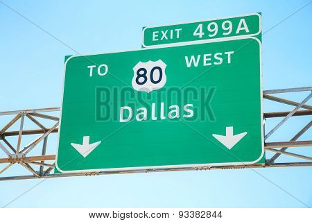 Road Sign With The Direction To Dallas