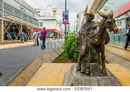 Drover statue with donkey in the commercial center of Armenia Colombia