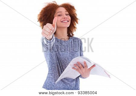 Black African American Student Girl Holding A Book And Making Thumbs Up Sign
