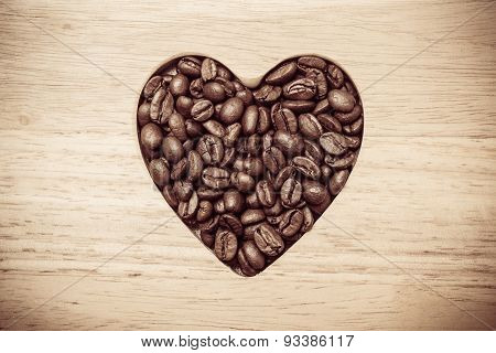 Heart Shaped Coffee Beans On Wooden Board