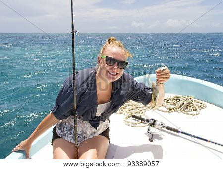 Woman With Fish Catch