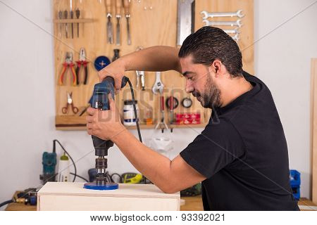 Artisan Using A Hole Saw