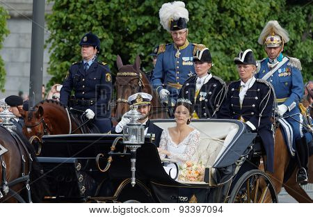 The Royal Coach Carrying The Swedish Prince Carl-philip Bernadotte And His Wife Waving And Smiling